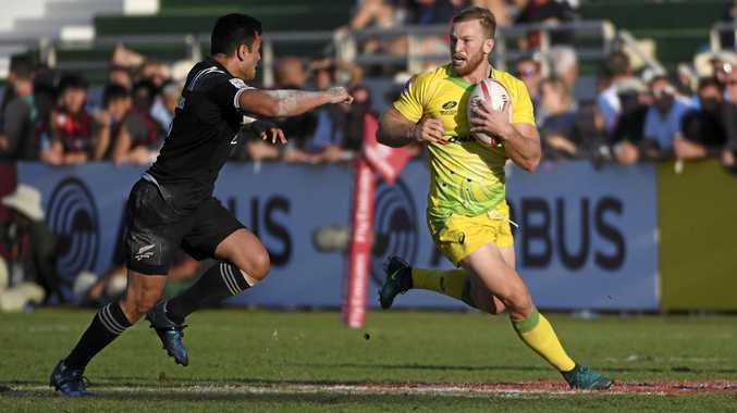 New Zealand's Sherwin Stowers, left, runs to tackle Australia's Boyd Killingworth in the fifth place semi-final during the World Rugby Sevens Series.
