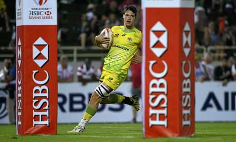 Australia's Tim Anstee scores the try against Scotland in the fifth place match of the World Rugby Sevens Series.