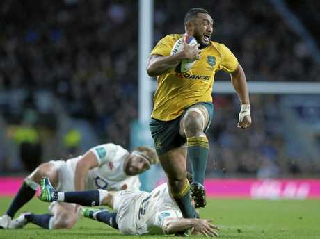Australia's Sekope Kepu gets free of England's Owen Farrell's tackle to run on and score a try.