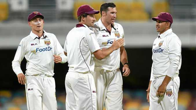 Queensland's Joe Burns (centre) celebrates with bowler Luke Feldman (second right) after dismissing New South Wales batsman Peter Nevill during the first day of their Sheffield Shield match at in October.