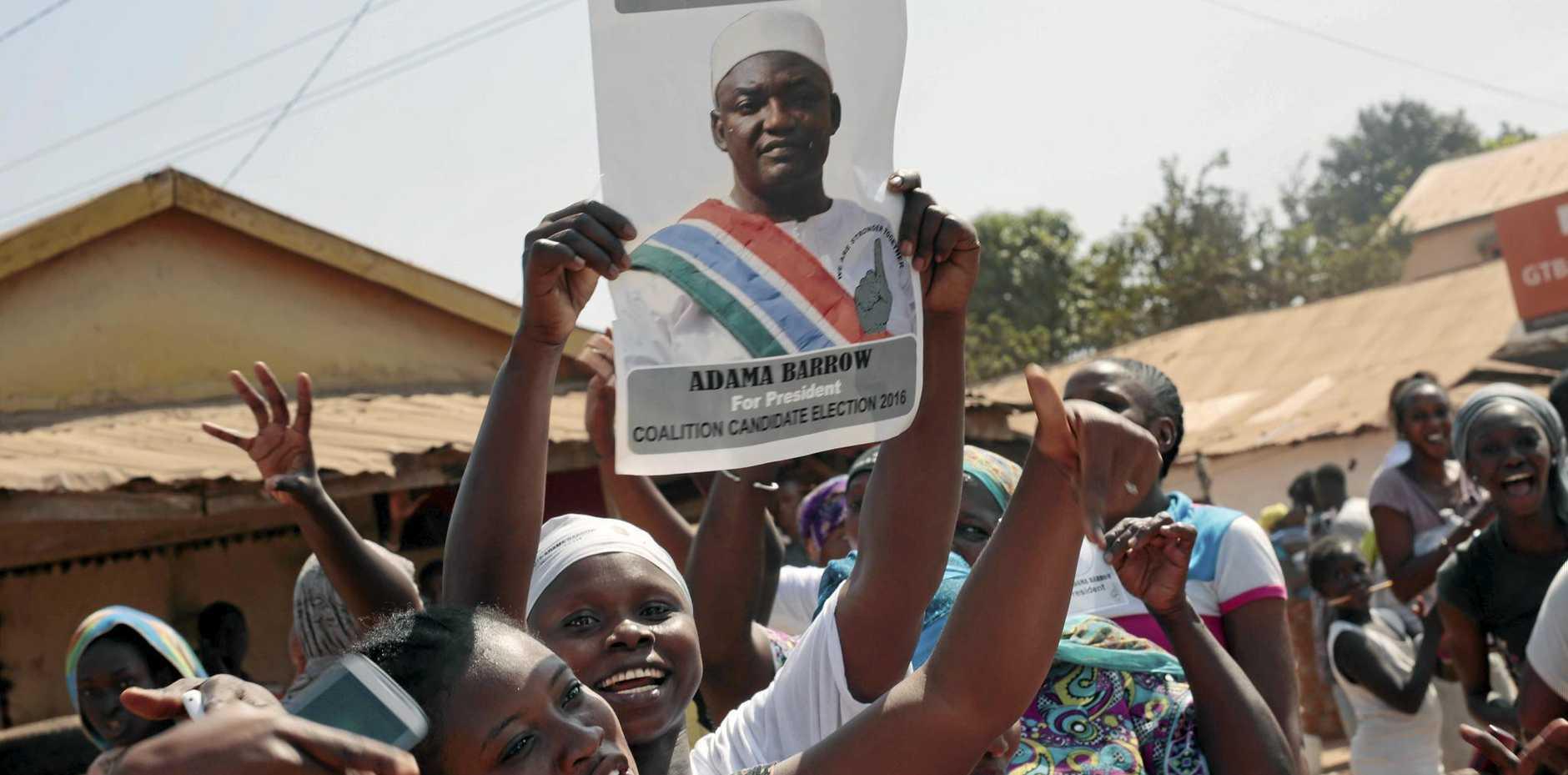 Gambians celebrate the victory of Adama Barrow against long-time president Yahya Jammeh in the streets of Serrekunda.