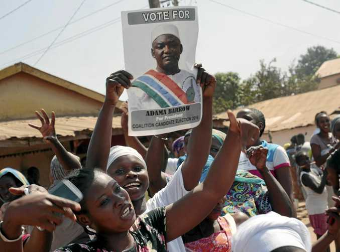 Gambians celebrate the victory of Adama Barrow against long-time president Yahya Jammeh in the streets of Serrekunda.