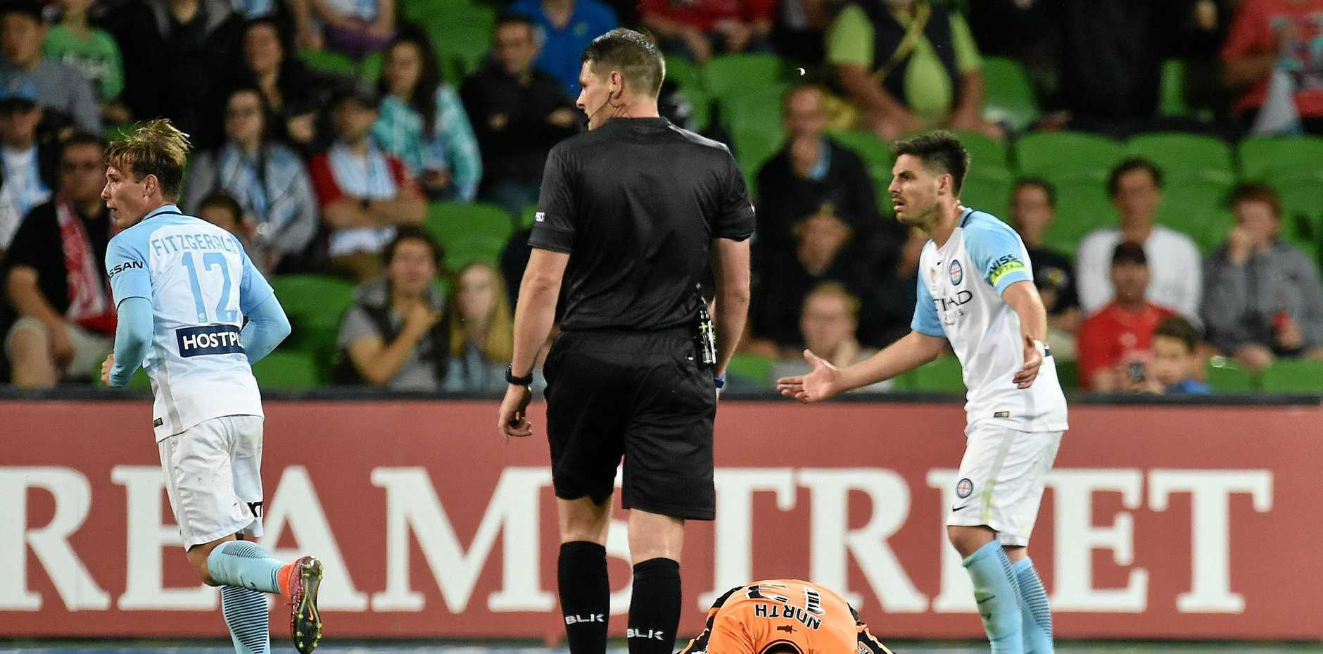 Roar player Jade North on the ground in the game between Melbourne City and Brisbane at AAMI Park.