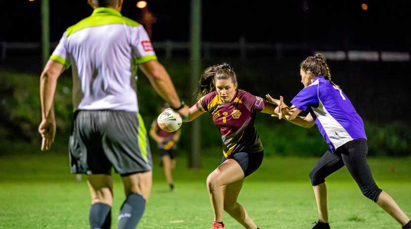 TOUCHED: Lily McGrath plays her part in an action-packed Gympie High B Grade Mixed event.