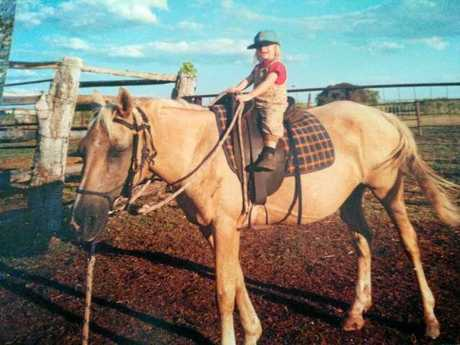RIGHT: Two-year-old Tiffany riding her horse Ice Cream.