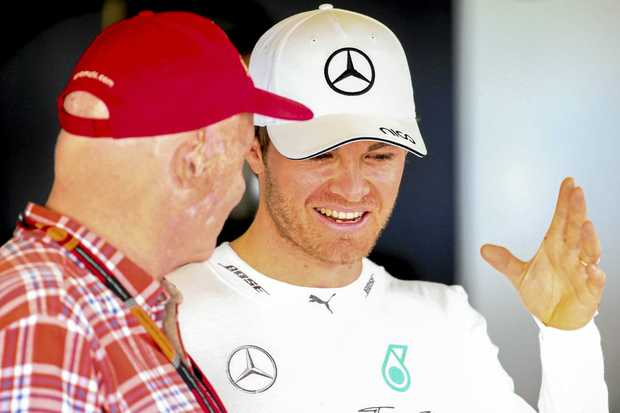 Nico Rosberg  talks to Niki Lauda.