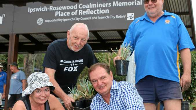 TEAM EFFORT: Rotary Club members Chris Wendt, Clive Fox, president Paul Pisasale and Rowarn Luder lend a hand planting shrubs at the new Reflection Shelter.