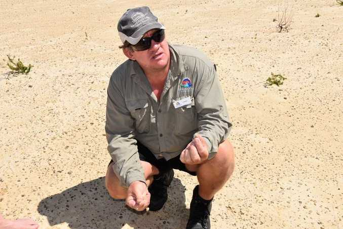 A guide shows off the rocks created by lightning strikes on Moreton Island.