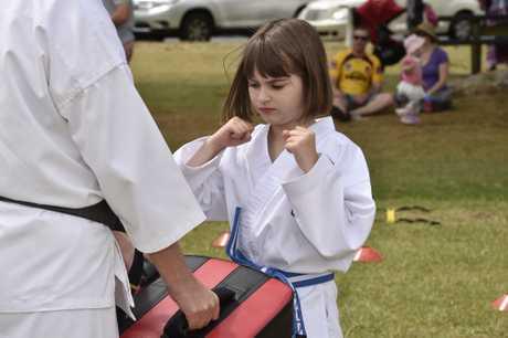 Demonstrating Karate, Talia Sharpe of Sharpe's Kids Karate.