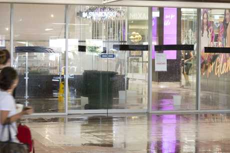 Water can be seen flooding areas of Grand Central shopping centre, Sunday, December 04, 2016.