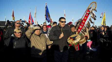 A Native American drum procession moves through the Oceti Sakowin camp after it was announced that the U.S. Army Corps of Engineers won't grant easement for the Dakota Access oil pipeline in Cannon Ball, N.D., Sunday, Dec. 4, 2016.