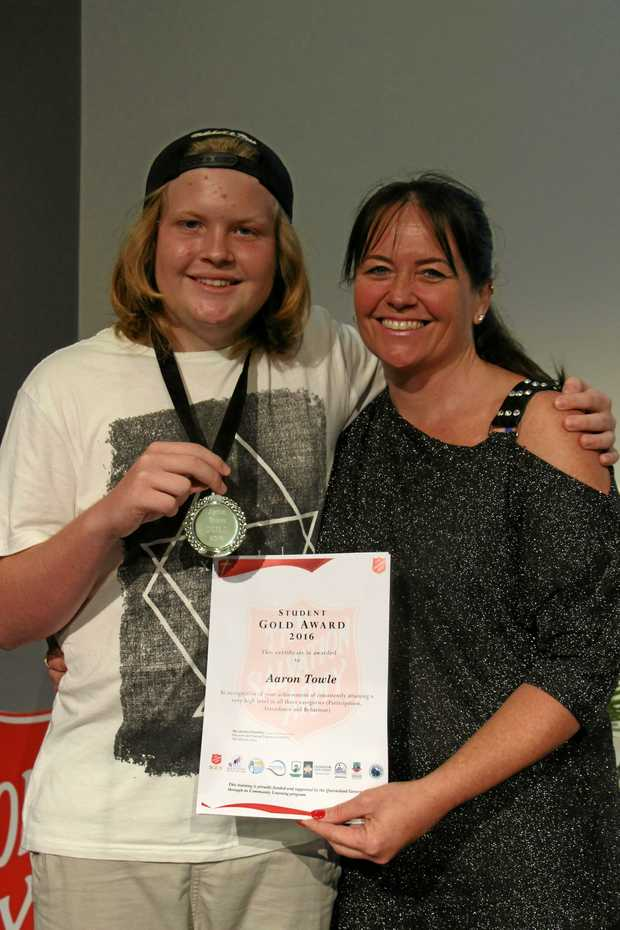 PROUD: Aaron Towle holds his medal and award with his mum Michelle Towle.