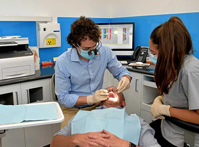 AT WORK: Dr. Trent Davidson, of Plaza Central Dentists, with a patient.