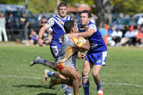 Grafton Ghosts' Cameron Stewart is pushed away by Coffs Comet player in the 2014 Group 2 reserve grade grand final.
