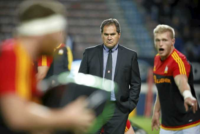 Chiefs head coach Dave Rennie looks at his players warming up ahead of the Super Rugby quarter-final match.