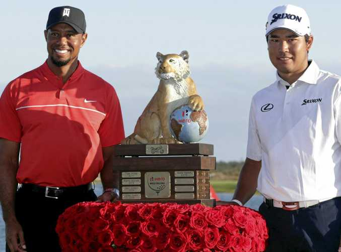 Hideki Matsuyama, right, of Japan, poses with Tiger Woods after winning the Hero World Challenge golf tournament raising money for the Tiger Woods foundation.