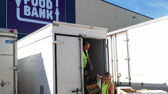Ron and Claire for Foodbank Queensland working hard loading up donations.