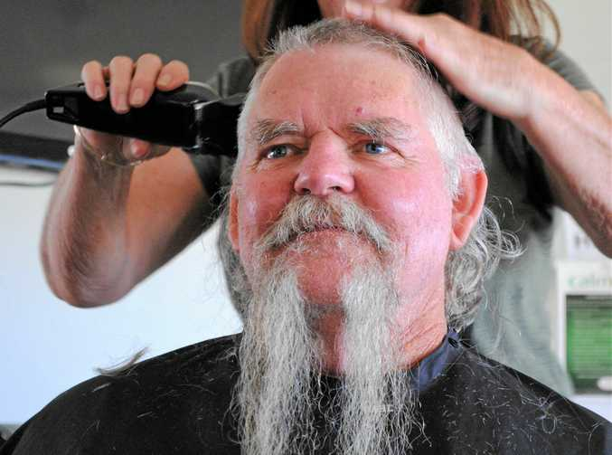 GOING, GOING: Darryl Kopp shaved the beard he's kept for more than 30 years for the Movember Foundation. (INSET) GONE: Darryl Kopp looked like a new man once his beard and head had been shaved.