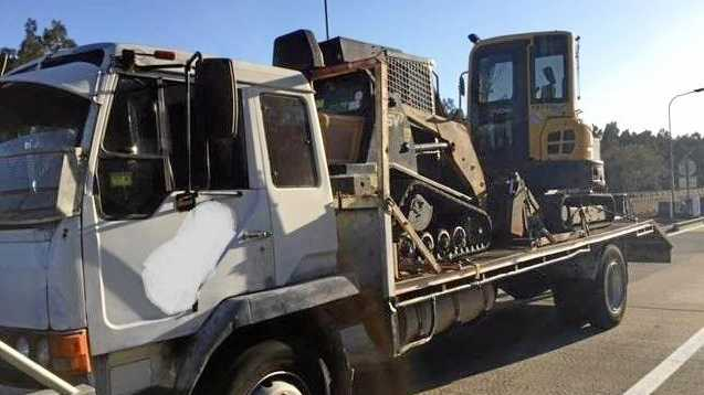 A heavy vehicle driver was charged with mid-range drink-driving and driving unlicensed after his truck - which was carrying a large excavator - was pulled over.