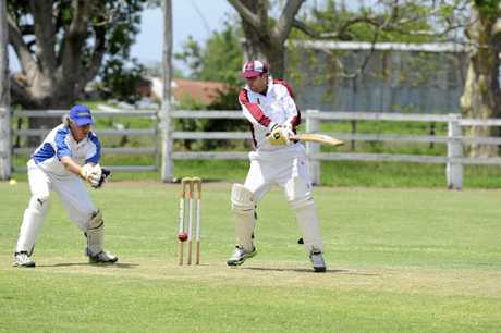 Tucabia's wicket keeper Derek Woods and Brothers batsman Troy McLennan during the Clarence River Cricket Association second grade match between Brothers and Tucabia on at Small Park Ulmarra Saturday, 20th December, 2014. Photo Debrah Novak / The Daily Examiner