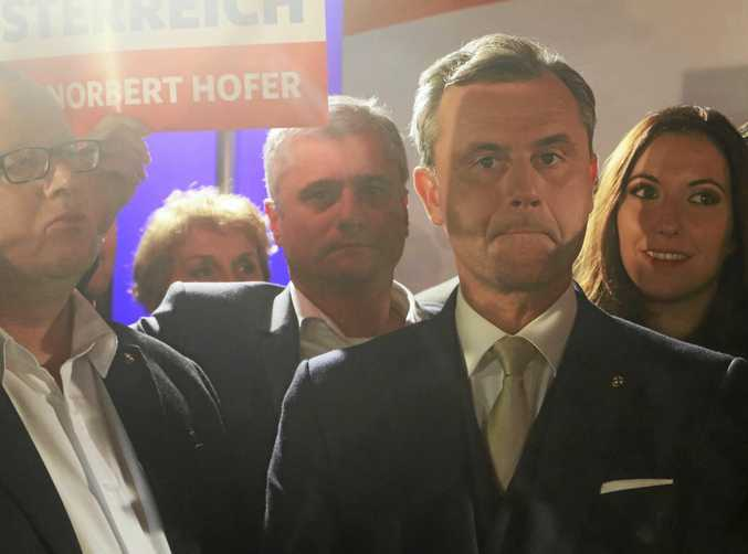 Norbert Hofer, presidential candidate of Austria's anti-migrant and anti-EU Freedom Party, is surrounded by supporters at the parliament in Vienna as the votes roll in.
