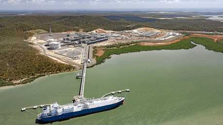 Aerial view of the Cool Voyager LNG ship at the Santos GLNG project on Curtis Island, near Gladstone in Queensland, Australia. The first of two GLNG production trains was handed over to the customer, Santos, in October 2015. The GLNG project is one of three plants built by Bechtel on Curtis Island, near Gladstone in Queensland, Australia. The projects, QCLNG, GLNG and Australia Pacific LNG (APLNG) will have a capacity to produce 25 million tonnes of LNG per annum when complete in 2016.