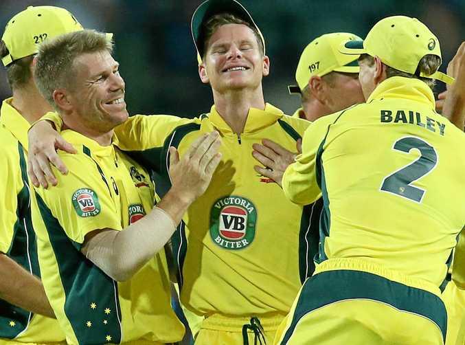 Australian captain Steve Smith (centre) celebrates with his teammates after catching New Zealand batsman BJ Watling.
