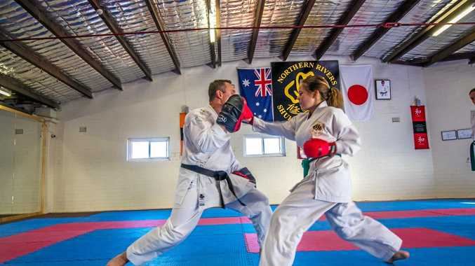 Tia Steele, 13,   pictured with head instructor Barry Potts at the Northern Rivers Shukokai Karate Dojo. INSET: Kane Williams, Emily Yee, Tia Steele & Imogen Crampton at the Melbourne martial arts competition last month.