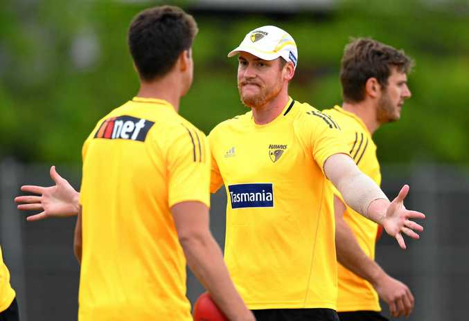He's back ... Jarryd Roughead has fun with teammates during a Hawks pre-season training session at Waverley Park