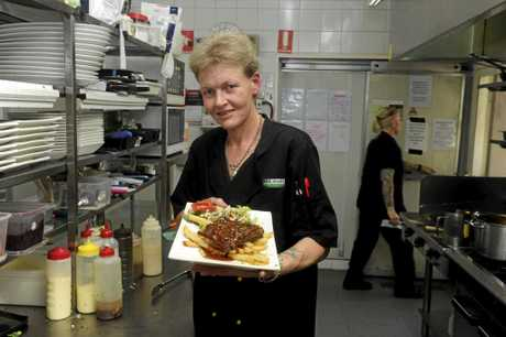 Village Green Hotel chef Nerida Cotten with the the $10 Monday special ribs, winner of the 2016 NSW AHA Best Cheap Meal Under $15.