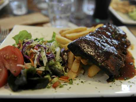 The $10 Monday special ribs at the Village Green Hotel, winner of the 2016 NSW AHA Best Cheap Meal Under $15.
