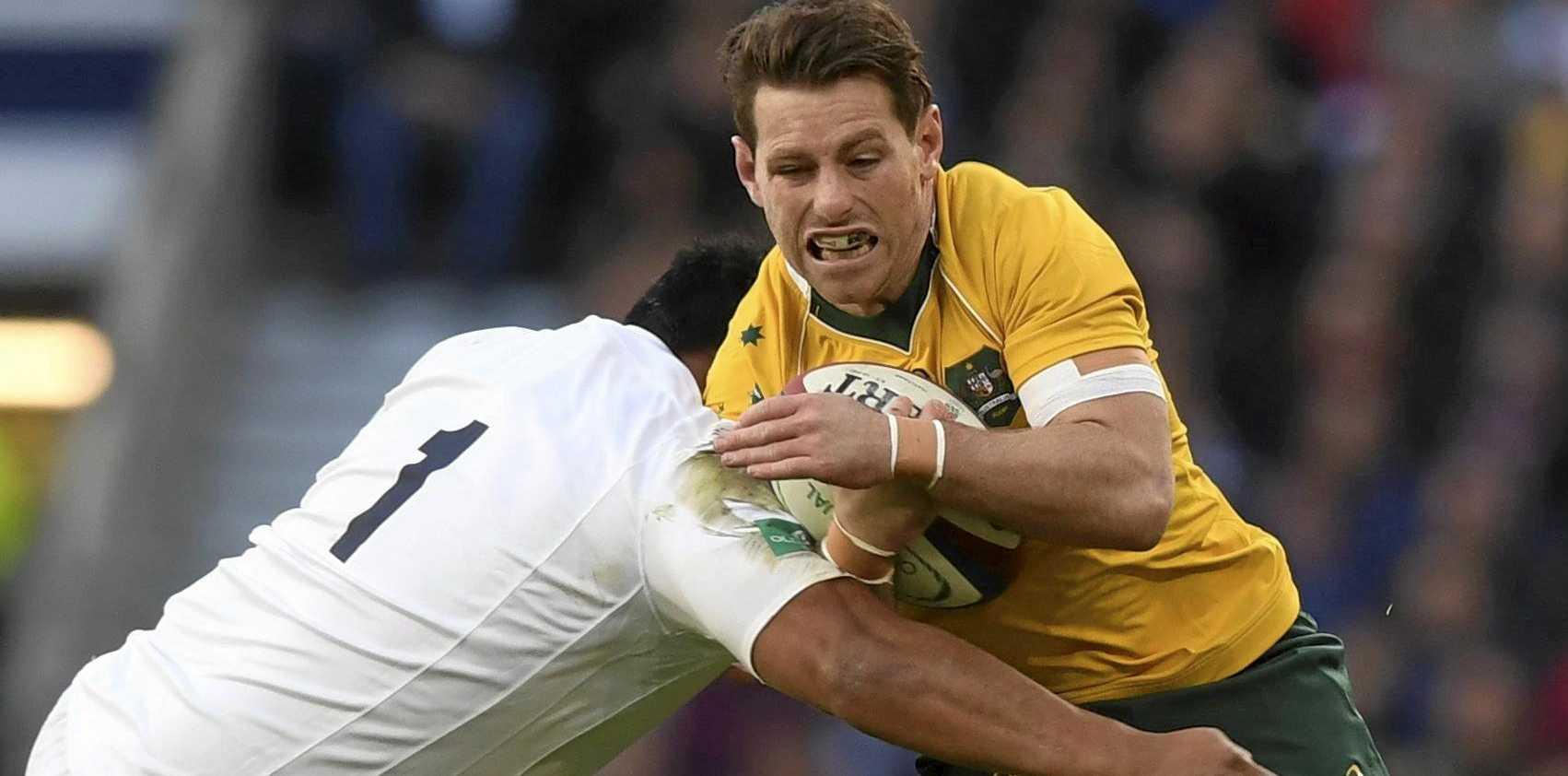 Australia's Bernard Foley is tackled by England's Mako Vunipola.