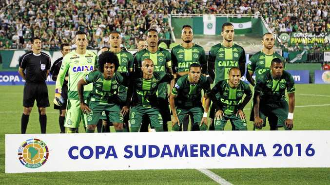 Chapecoense players line up for a group picture before the Sudamericana Cup semi-finals.