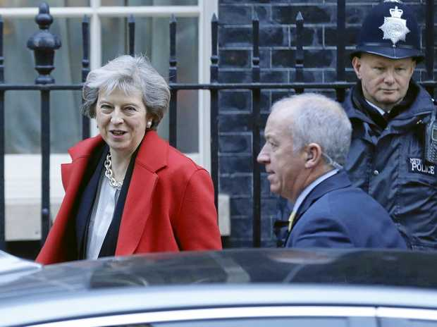 Britain's Prime Minister Theresa may leaves 10 Downing Street for the House of Commons for her weekly Prime Minister's Questions in London, Wednesday Nov. 30, 2016. (AP Photo/Alastair Grant)