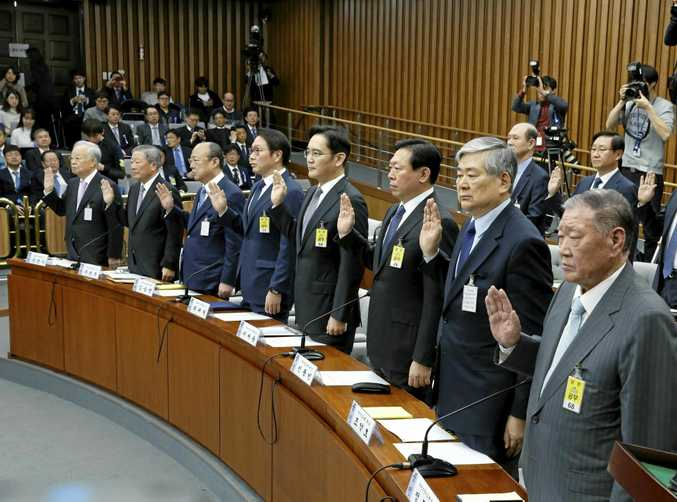 The chairmen of eight of South Korea's biggest companies take an oath during a parliamentary hearing at the National Assembly in Seoul.