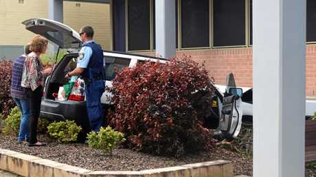 It is believed the woman accidentally accelerated into the building while parking.