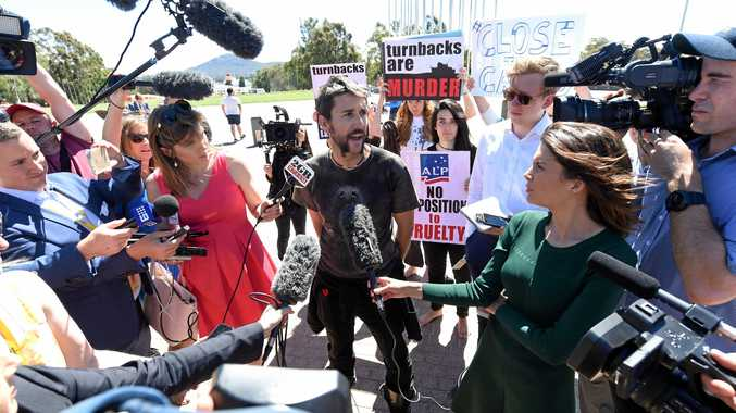 PURE FRUSTRATION: A pro-refugee protester speaks to the media outside Parliament House in Canberra on Thursday.