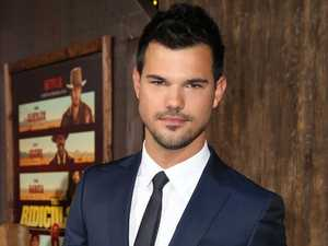 Taylor Lautner 'spotted smooching co-star'