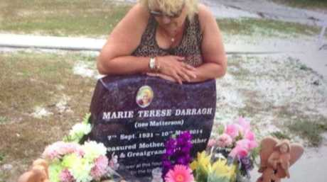 Charli Darragh at the grave site of her mother, Marie Darragh.