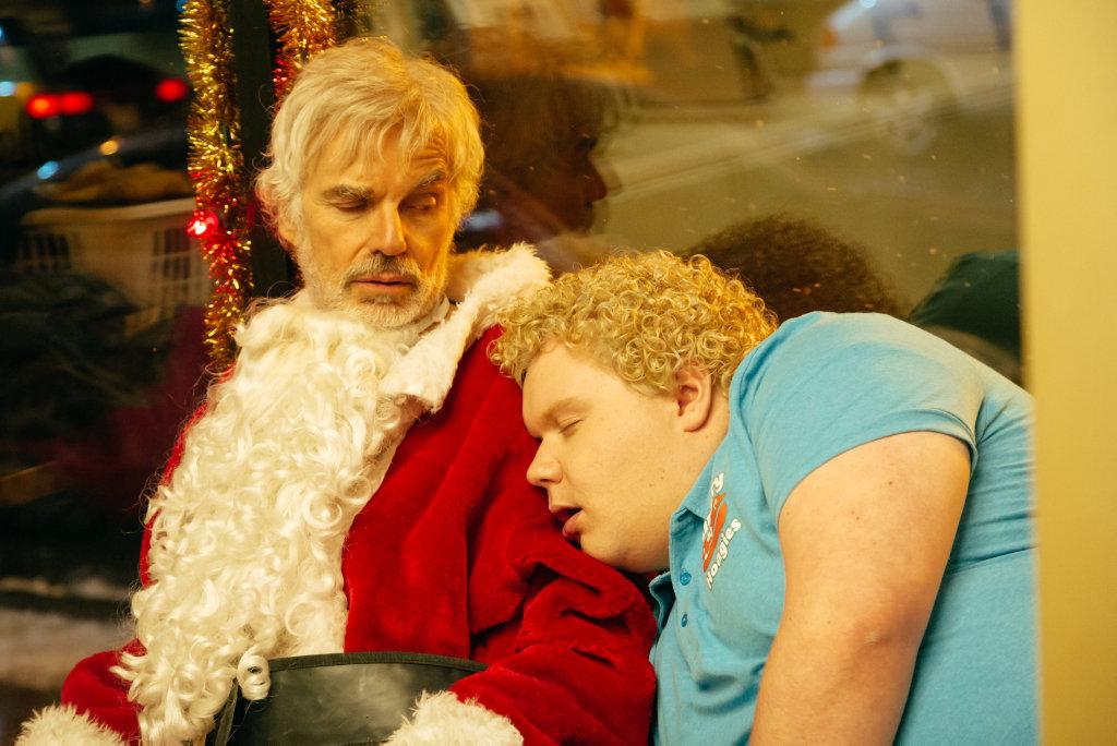 Billy Bob Thornton and Brett Kelly in a scene from Bad Santa 2.