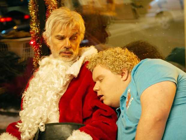 Billy Bob Thornton and Brett Kelly in a scene from Bad Santa 2.