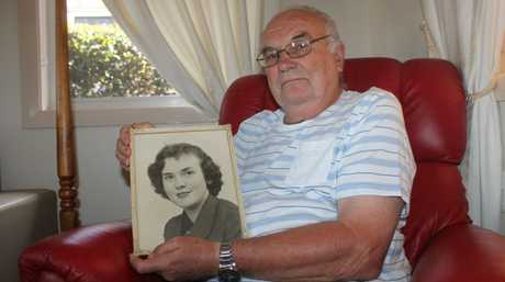 Donald Spencer with a photo of his late sister, Isabella.