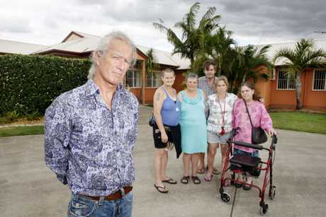 Manager for Christine Court, Grant Kelly, with residents after the 2011 floods when the group was asked to leave an emergency shelter. (file photo)