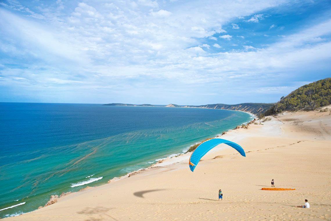 Fly away to beautiful Rainbow Beach.