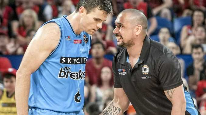 Breakers coach Paul Henare talks to player Kirk Penney.