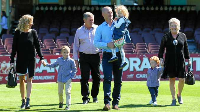 Australian cricketer Brad Haddin walks on to the SCG holding his daughter Mia accompanied by (from left) his wife Karina, oldest son Zac, father Ross, youngest son Hugo and mother Anne after announcing his retirement in 2015.