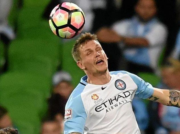 Michael Jakobsen of Melbourne City goes up for a header.