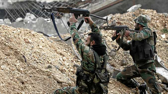 Syrian army soldiers fire at rebel fighters at the Ramouseh frontline, east of Aleppo, Syria.