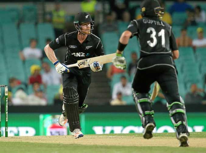 New Zealand's Jimmy Neesham (left) makes a run with batting partner Martin Guptill.