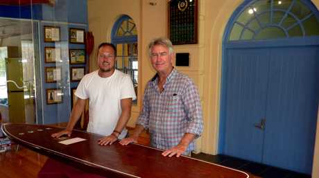 Filmmakers Shaun Cairns and Phil Jarratt pictured with a traditional Hawaiian wooden surfboard. The men have produced the Australian surfing documentary Men of Wood & Foam for the History Channel.